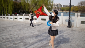 Life is slowly returning to normal in cities like Beijing and Shanghai though people are still wearing masks in public