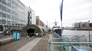 Members of the Defence Forces setting up a test centre at the LÉ Samuel Beckett on Sir John Rogerson's Quay in Dublin