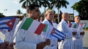 Doctors and nurses from Cuba's Henry Reeve International Medical Brigade are bid farewell before they travel to Italy to help in the fight against the coronavirus pandemic