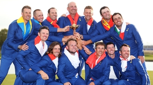 Tommy Fleetwood (front row, 2nd from L) and his 2018 Ryder Cup team-mates with the trphy