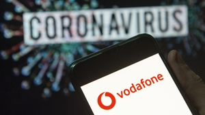Vodafone has reported a 2.6% rise in full-year core earnings to €14.9 billion