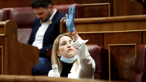 Citizens party member Maria Munoz Vidal wears protective equipment at the plenary session at the Lower Chamber in Madrid