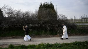 Priests in Italy conduct a countryside procession to bless houses against the coronavirus pandemic