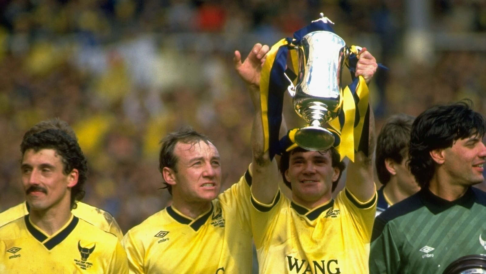Image - David Langan and Ray Houghton of Oxford United lift that year's League Cup trophy aloft