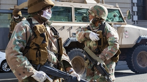 Members of the South African National Defence Force patrol a street in Johannesburg, South Africa, the continent's worst-affected country