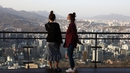 People watch the sun set in Seoul