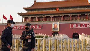 Police offers stand guard at Tiananmen Gate