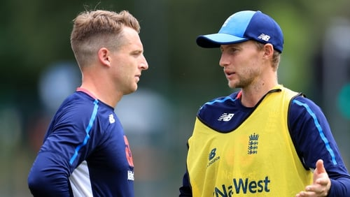 The wages of Joe Root (right) and Jos Buttler won't be reduced