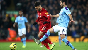 Ilkay Gundogan and Alex Oxlade-Chamberlain vie for possession during Liverpool's 3-1 league win in November