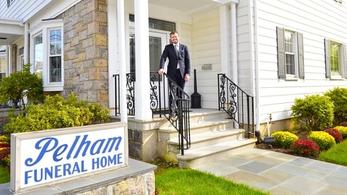 Clive Anderson on the steps of Pelham Funeral Home in Westchester County