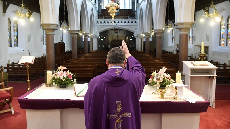 Fr Martin Cosgrove saying mass in an empty Church of the Annunciation in Rathfarnham in Dublin which was transmitted live online. Photo: Aidan Crawley/EPA-EFE
