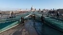 People observe social distancing on the Millennium Bridge in London