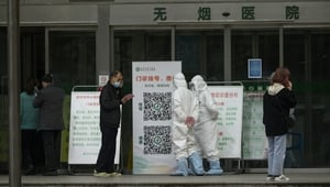 Medical workers standing in front of the Wuhan Central Hospital in Wuhan, in China's central Hubei province