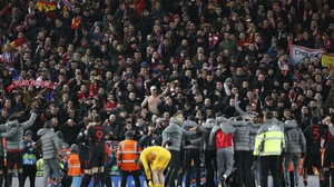 Atletico fans in the Anfield stands celebrate the win over Liverpool