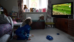 Lois Copley-Jones, aged 5, watches the Virtual Grand National
