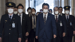 Shinzo Abe wearing a face mask, arrives for a committee at the lower house of parliament in Tokyo