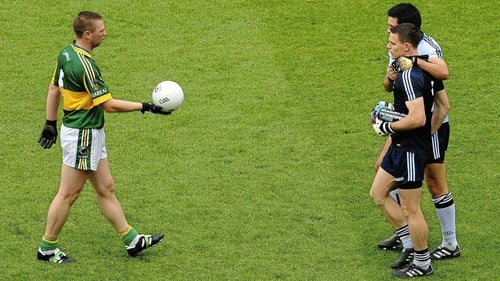 Tomas Ó Sé offers the match ball to Stephen Cluxton after the 2011 All-Ireland SFC final