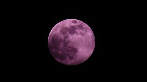 Pink super moon rises above London
