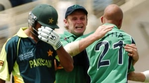 Andre Botha, Ireland, celebrates with William Porterfield after taking the wicket of the distraught Imran Nazir
