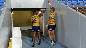 Maika Sivo and Kane Evans of the Eels leave the field after final NRL match of season thus far against the Gold Coast Titans