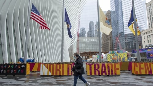 Flags fly at half-mast outside the World Trade Center in New York