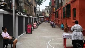 People maintain social distancing during Good Friday prayers in Kolkata
