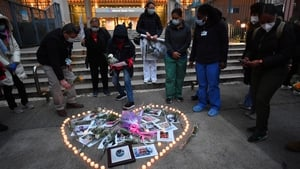 Nurses and healthcare workers in New York light candles for colleagues who died