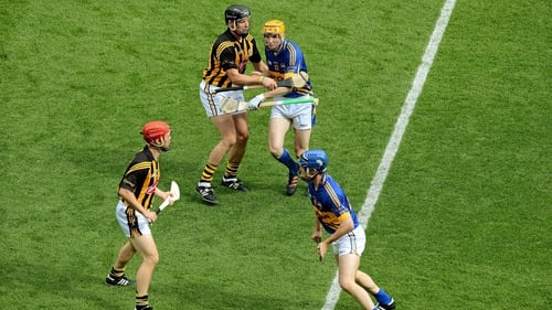 Jackie Tyrrell (top left) tries to politely dissuade Lar Corbett from following Tommy Walsh, (bottom left) in the 2012 semi-final