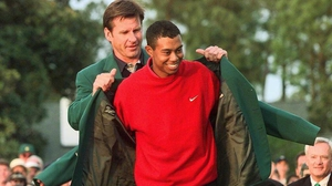 Nick Faldo helps Tiger Woods into the Green Jacket in 1997