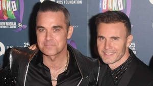 Robbie Williams and Gary Barlow entire fans via social media