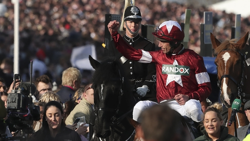 Jockey Davy Russell celebrates after riding Tiger Roll to Grand National victory in 2018