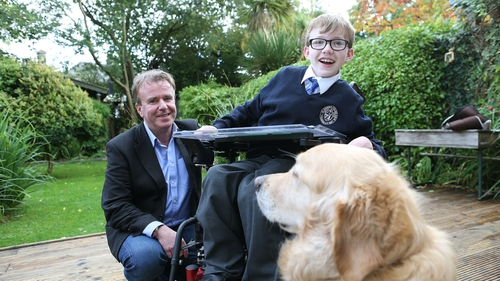 Tom Clonan with this son Eoghan and assistance dog Duke