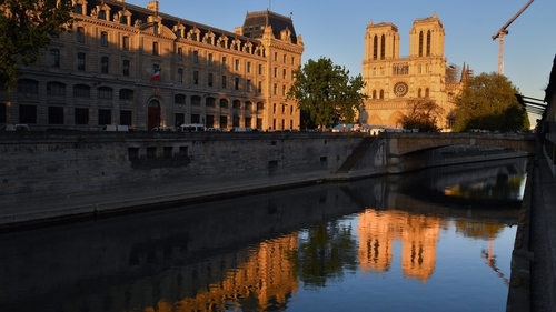 The Notre-Dame Cathedral at sunset during the ring of the Bourdon bell on the first anniversary of the fire