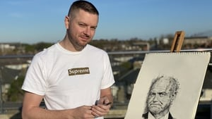 Shane Gillen with his portrait of Dr Tony Holohan