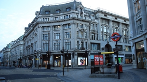 Deserted city streets, like Oxford Circus in London, have been a familiar site around the world this past year