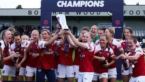 Arsenal's Kim Little (holding trophy on right) won the Super League alongside Irish pair Louise Quinn and Katie McCabe last season