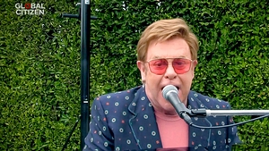 Face value: Elton John in a recent performance