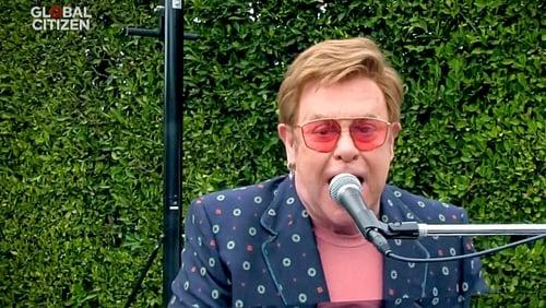 Face value: Elton John in a recent performance