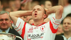 Peter Canavan prepares to lift the Sam Maguire Cup in 2003