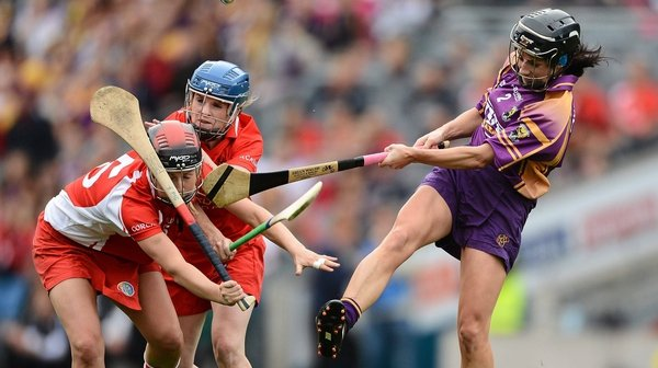 Cork's Síle Burns and Briege Corkery attempt to block Claire O'Connor of Wexford