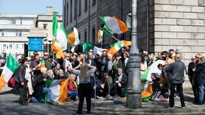 """""""According to the Health Act 1947, this gathering in support of John Waters and Gemma O'Doherty outside the Four Courts in Dublin was a punishable offence"""" Photo: Tom Honan for The Irish Times."""