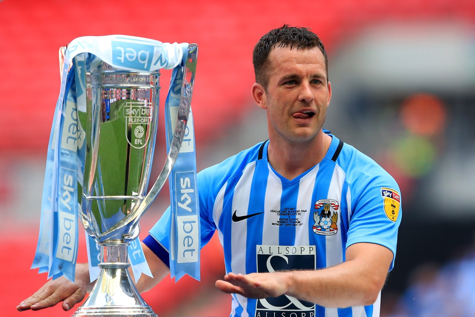 Image - Doyle with the League Two Play Off Final trophy in May 2018