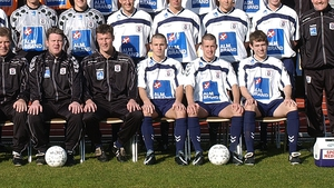 Liam Miller and Michael Doyle sitting front row in AGF's squad photo for 2002