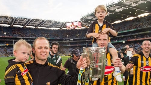 Henry Shefflin (R) and his son Henry and Tommy Walsh, with his son Finn, celebrate the 2014 All-Ireland final defeat of Tipperary