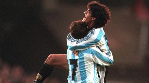 Argentina's Ariel Ortega celebrates his memorable goal at Lansdowne Road with Claudio Lopez