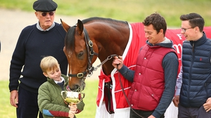 Joseph O'Brien (R) with Rekindling and owner Lloyd Williams (L) after the horse's Melbourne Cup win in 2017