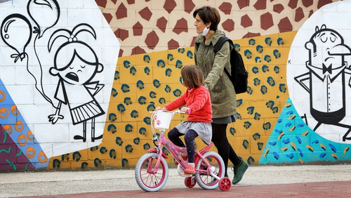 A mother and child out and about in Igualada, Spain, the first time minors have been allowed out in 44 days
