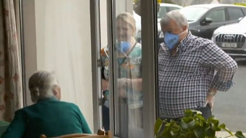Visitors looking through the windows of Abbot Close care home in Askeaton