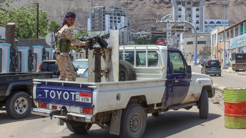 A fighter with Yemen's separatist Southern Transitional Council mans a gun in the back of a pick-up in Aden