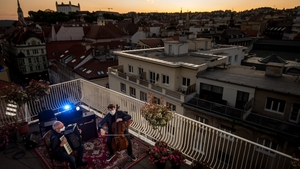 Musicians perform on a terrace of the Municipal Theatre during an online streamed concert in Bratislava